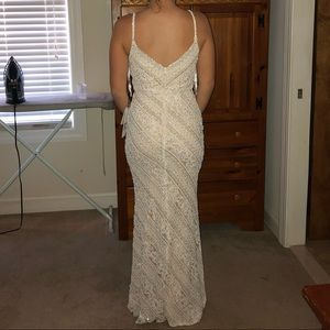 Jovani, style number 62488 in the color ivory